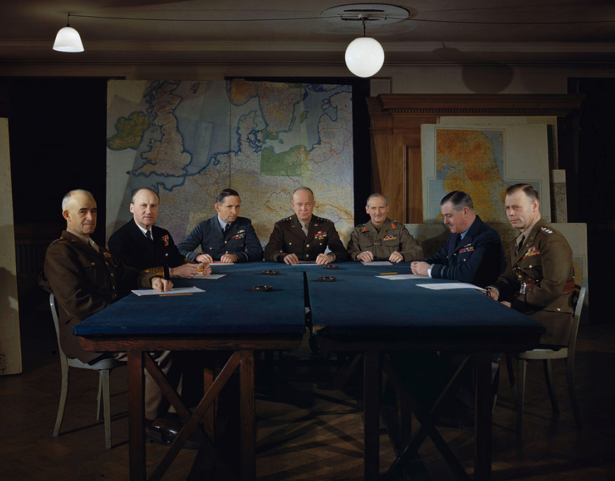 <p>US General Dwight D.Eisenhower plots with his commanders at Supreme Allied Headquarters in London, 1944 (Picture: PA) </p>