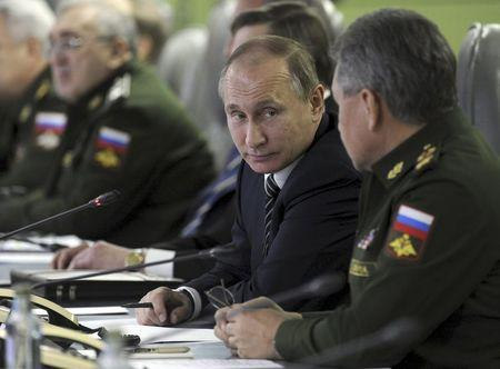 Russian President Vladimir Putin looks at Defence Minister Sergei Shoigu as they attend a meeting dealing with the commissioning of military products at the National defence control centre in Moscow, Russia, in this March 11, 2016 file photo. REUTERS/Mikhail Klimentyev/Sputnik/Kremlin/Files
