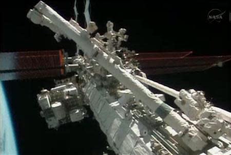 Flight engineers Michael Hopkins and Richard Mastracchio perform a series of spacewalks outside the International Space Station (ISS) in this December 21, 2013 still image taken from a NASA handout video. REUTERS/NASA/Handout via Reuters