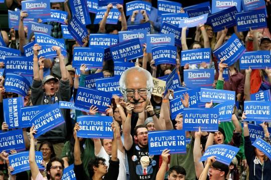 Students and supporters of Sen. Bernie Sanders hold signs during a campaign rally at Colorado State University in Fort Collins, Colo. (Photo: Jacquelyn Martin/AP)