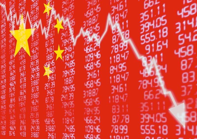 Downward pointing stock chart superimposed on Chinese flag and columns of numbers