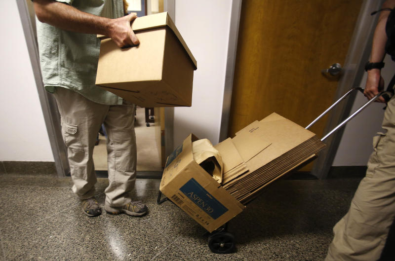 FBI agents leave with boxes of material from the Capitol office of State Sen. Ron Calderon, D-Montebello, in Sacramento, Calif., Tuesday, June 4, 2013. Search warrants were served about at Calderon's office and the office of the Legislature's Latino caucus, around 3 p.m., but would not disclose the reason for the investigation. Calderon was not present during the search.(AP Photo/Rich Pedroncelli)