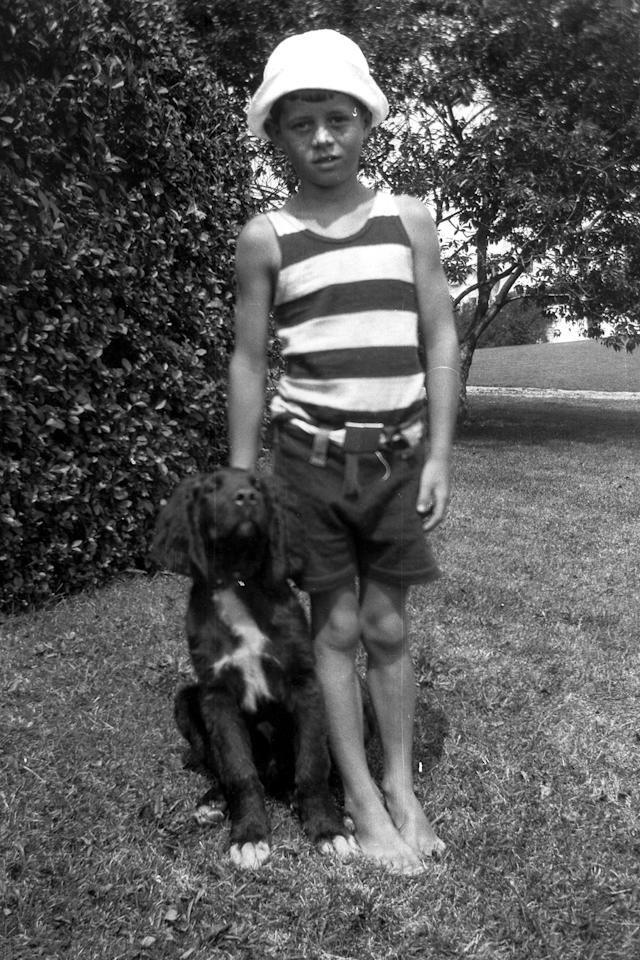 <p>John F. Kennedy with dog, Bobby, in Hyannis Port, Mass., in 1925. (Photo: John F. Kennedy Library Foundation) </p>