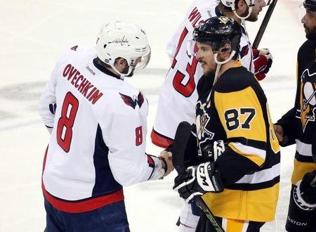 May 10, 2016; Pittsburgh, PA, USA; Washington Capitals left wing Alex Ovechkin (8) and Pittsburgh Penguins center Sidney Crosby (87) shake hands after game six of the second round of the 2016 Stanley Cup Playoffs at the CONSOL Energy Center. The Pens won 4-3 in overtime to win the series 4 games to 2. Mandatory Credit: Charles LeClaire-USA TODAY Sports