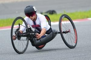Oksana Masters competing in the women's H4-5 cycling time trial at the 2021 Tokyo Paralympics.