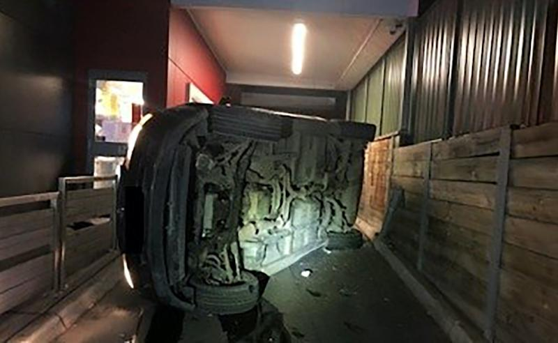 Pictured is the car flipped in the drive-tru.