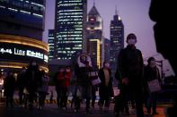 People wearing protective face masks are seen on a crossroads as the country is hit by an outbreak of the novel coronavirus, in Shanghai