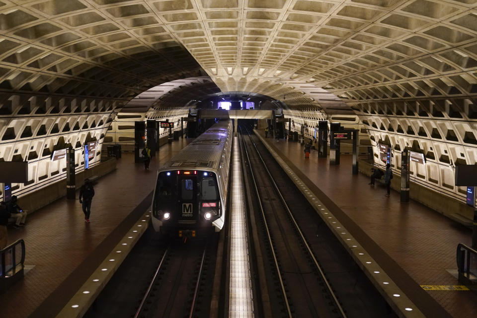 A train arrives at Metro Center station, Friday, April 23, 2021, in Washington. As President Joe Biden urges more federal spending for public transportation, transit agencies decimated by COVID-19 are struggling with a new uncertainty: how to win passengers back. (AP Photo/Patrick Semansky)