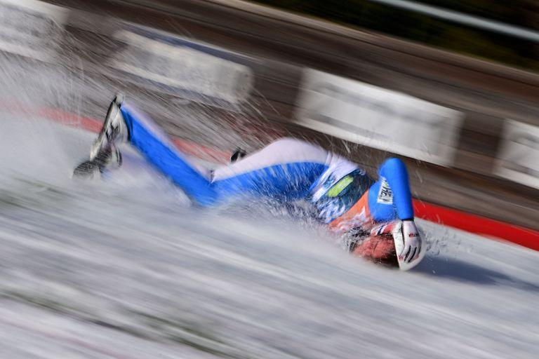 TOPSHOT - Norway's Daniel Andre Tande falls to the ground during the FIS Ski Jumping World Cup Flying Hill Individual competition in Planica on March 25, 2021. (Photo by Jure MAKOVEC / AFP)
