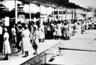 """<p>Lines quickly formed for the opening of the store, which was self-labeled as the """"1st"""" Quality Discount Center.""""</p><p>Photo: Courtesy of The Walmart Museum</p>"""