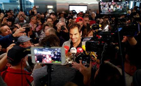 Switzerland's Roger Federer talks to the media upon his arrival at Zurich Airport, Switzerland January 30, 2018. REUTERS/Arnd Wiegmann