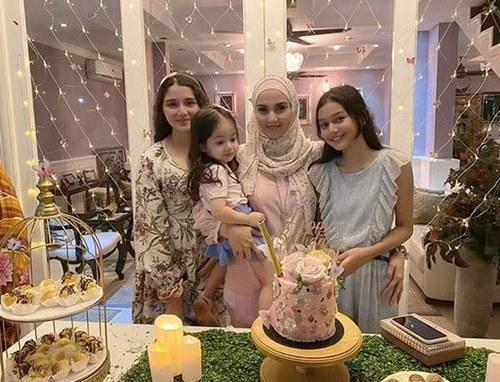 Fiza and her three daughters