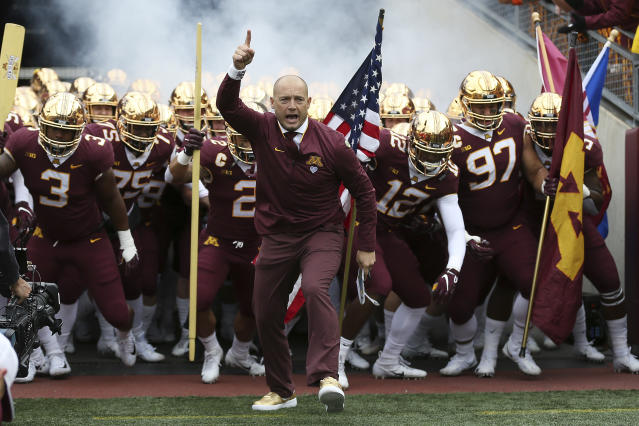 Minnesota head coach P.J. Fleck leads him team onto the field prior to the start of an NCAA college football game. (AP)