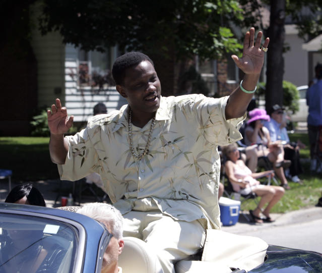 Pernell Whitaker waves to the crowd during a parade before he was inducted into the International Boxing Hall of Fame in Canastota, N.Y., Sunday, June 10, 2007. (AP Photo/Mike Groll)