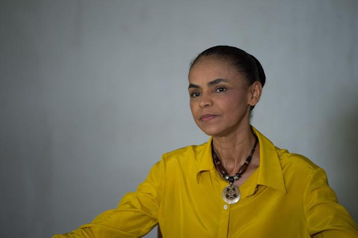 Brazilian Marina Silva presidential candidate for the Brazilian Socialist Party (PSB) poses after voting at a polling station in Rio Branco, western Brazil on October 5, 2014 (AFP Photo/Yasuyoshi Chiba )