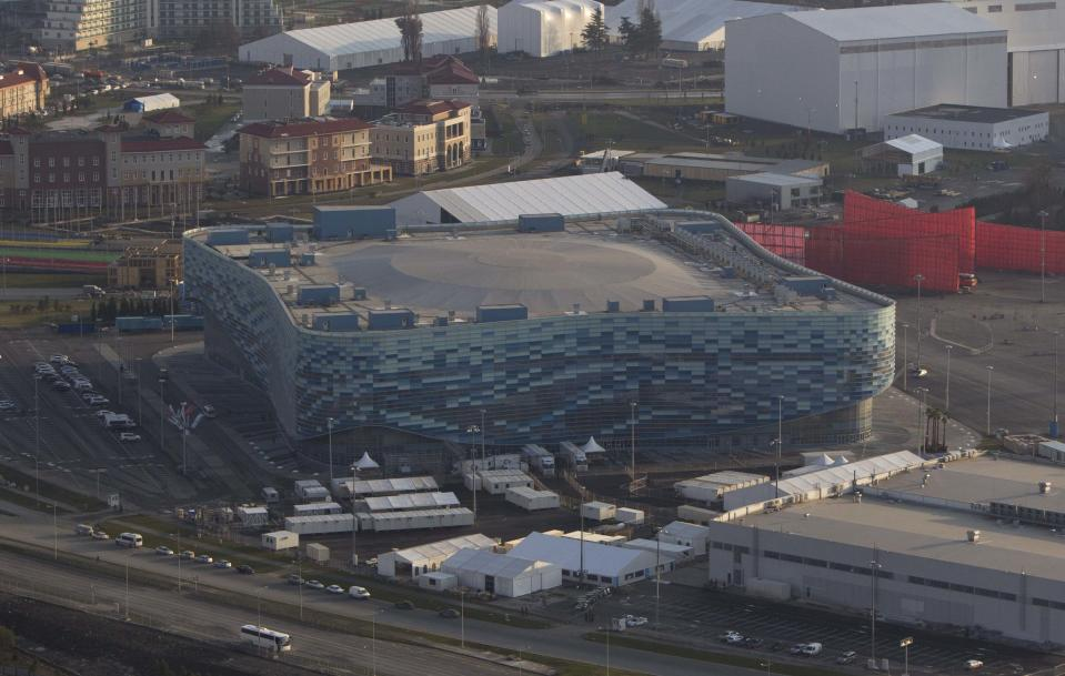 "An aerial view from a helicopter shows the ""Iceberg"" Skating Palace at the Olympic Park in the Adler district of the Black Sea resort city of Sochi, December 23, 2013. Sochi will host the 2014 Winter Olympic Games in February. Picture taken December 23, 2013. REUTERS/Maxim Shemetov (RUSSIA - Tags: CITYSCAPE BUSINESS CONSTRUCTION SPORT OLYMPICS)"