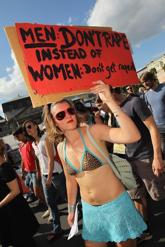 "BERLIN, GERMANY - AUGUST 13:  A young woman participates in the ""Slut Walk"" march on August 13, 2011 in Berlin, Germany. Several thousand men and women turned out to protest against rape and a woman's right to her body.  (Photo by Sean Gallup/Getty Images)"