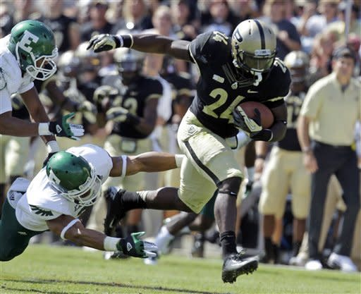 Purdue running back Akeem Shavers, right, gets away from Eastern Michigan defensive backs Kevin Johnson, top left, and Donald Coleman on his way to a 40-yard touchdown during the first half of an NCAA college football game in West Lafayette, Ind., Saturday, Sept. 15, 2012. (AP Photo/Michael Conroy)