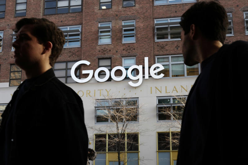 FILE - In this Dec. 4, 2017, file photo, people walk by Google offices in New York. Google is spending more than $1 billion to expand operations in New York City. Ruth Porat, senior vice president and chief financial officer at Google and Alphabet, said in a blog post Monday, Dec. 17, 2018, that Google is creating a more than 1.7 million square-foot campus that includes lease agreements along the Hudson River in lower Manhattan. (AP Photo/Mark Lennihan, File)