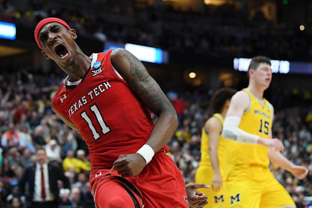 <p>Tariq Owens #11 of the Texas Tech Red Raiders celebrates after a dunk against the Michigan Wolverines during the 2019 NCAA Men's Basketball Tournament West Regional at Honda Center on March 28, 2019 in Anaheim, California. (Photo by Harry How/Getty Images) </p>
