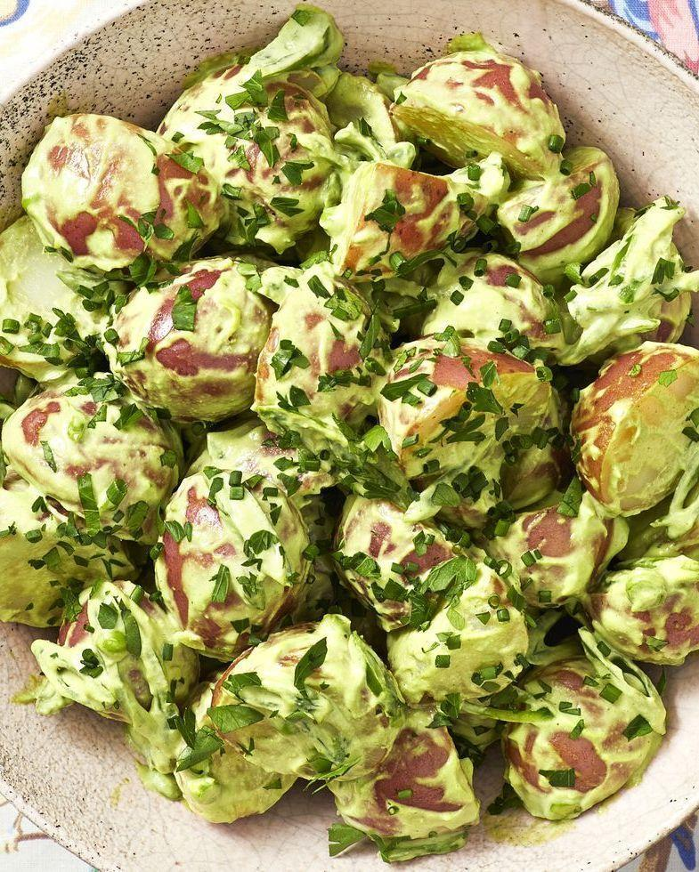 """<p>Vibrant and herby, this potato salad is exploding with flavors. It's a great addition to any Fourth of July picnic menu.</p><p><a href=""""https://www.thepioneerwoman.com/food-cooking/recipes/a35952688/green-goddess-potato-salad/"""" rel=""""nofollow noopener"""" target=""""_blank"""" data-ylk=""""slk:Get Ree's recipe"""" class=""""link rapid-noclick-resp""""><strong>Get Ree's recipe</strong></a>.</p><p><a class=""""link rapid-noclick-resp"""" href=""""https://go.redirectingat.com?id=74968X1596630&url=https%3A%2F%2Fwww.walmart.com%2Fbrowse%2Fhome%2Fthe-pioneer-woman-dishes%2F4044_623679_639999_7373615&sref=https%3A%2F%2Fwww.thepioneerwoman.com%2Ffood-cooking%2Fmeals-menus%2Fg32157273%2Ffourth-of-july-appetizers%2F"""" rel=""""nofollow noopener"""" target=""""_blank"""" data-ylk=""""slk:SHOP SERVING BOWLS"""">SHOP SERVING BOWLS</a></p>"""