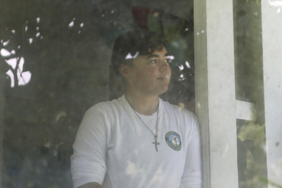 Charlie Thomas, of Auckland, New Zealand, stands in the doorway of a cabin under quarantine in Honolulu, Thursday, Nov. 5, 2020. Cut off from the rest of the planet since February, Thomas and three others are back, re-emerging into a society changed by the coronavirus outbreak. The expedition was her first time being away from home for so long, but she was ready to disconnect. (AP Photo/Caleb Jones)