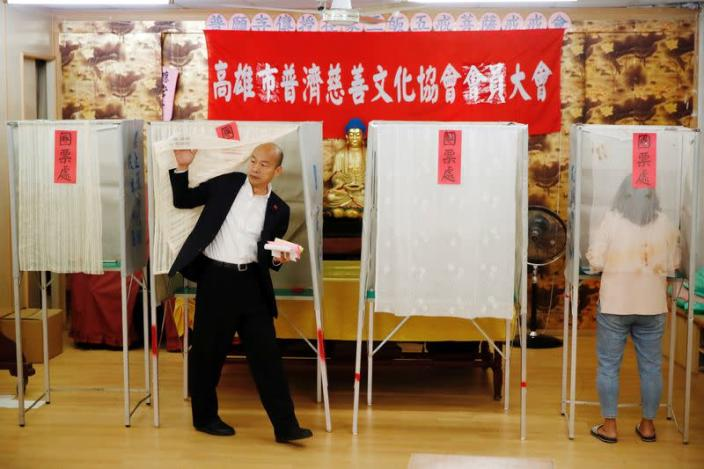 Taiwan's opposition Kuomintang Party (KMT) presidential candidate Han Kuo-yu votes at a polling station during general elections in Kaohsiung