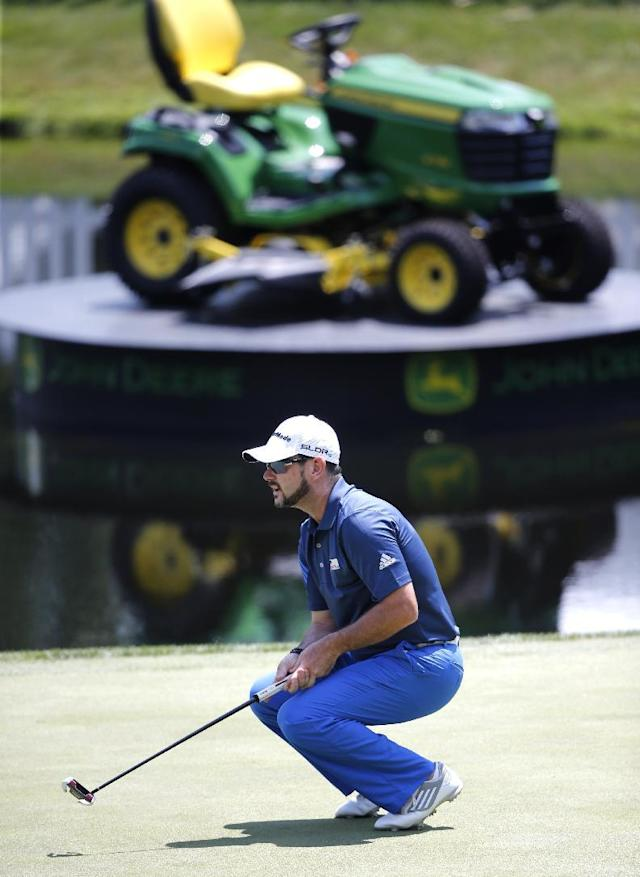 Rory Sabbatini reacts to missing a birdie putt on the 18th hole during the first round of the 2014 John Deere Classic golf tournament at TPC Deere Run in Silvis, Ill., Thursday, July 10 2014. (AP Photo/Charles Rex Arbogast)