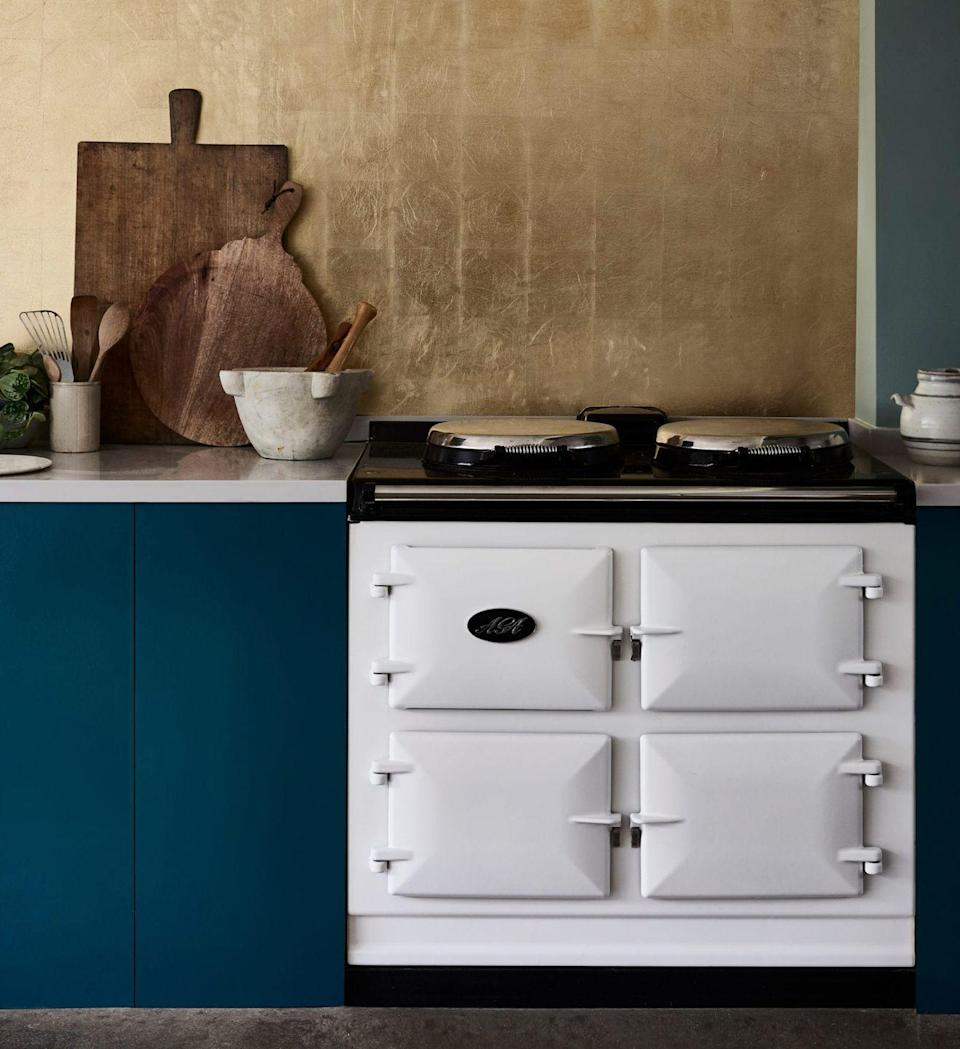 """<p>Gold is a common accent colour in deep blue and forest green kitchens, but here, it is the main event. The soft, matte sheen to this Annie Sloan gold leaf prevents it from becoming gaudy when used in large amounts, and the classic blue scheme is lightened a touch with a teal hue.</p><p>Pictured: <a href=""""https://www.anniesloan.com/product/chalk-paint/aubusson-blue/"""" rel=""""nofollow noopener"""" target=""""_blank"""" data-ylk=""""slk:Aubusson Blue"""" class=""""link rapid-noclick-resp"""">Aubusson Blue</a> and <a href=""""https://www.anniesloan.com/product/waxes-and-finishes/transfer-metal-leaf-booklets/"""" rel=""""nofollow noopener"""" target=""""_blank"""" data-ylk=""""slk:Metal Leaf"""" class=""""link rapid-noclick-resp"""">Metal Leaf</a>, both at Annie Sloane</p>"""