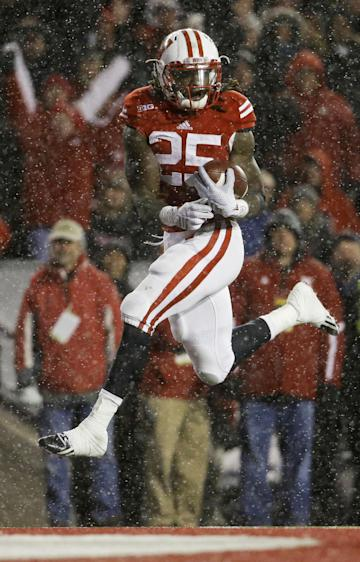 Wisconsin's Melvin Gordon scores on a 26-yard touchdown in the third quarter of an NCAA college football game against Nebraska Saturday, Nov. 15, 2014, in Madison, Wis. Gordon ran for 408 yards through three quarters Saturday, capping it off with this run to break the single-game major college football rushing record set on Nov. 20, 1999, when LaDanian Tomlinson with 406 yards on 43 carries for TCU against UTEP. (AP Photo/Morry Gash)