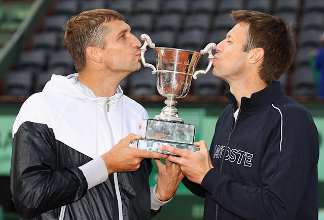 PARIS, FRANCE - JUNE 09: Max Mirnyi (L) of Belarus and Daniel Nestor of Canada pose with the winners trophy after defeating Bob and Mike Bryan of the USA in the men's doubles final during day 14 of the French Open at Roland Garros on June 9, 2012 in Paris, France. (Photo by Matthew Stockman/Getty Images)