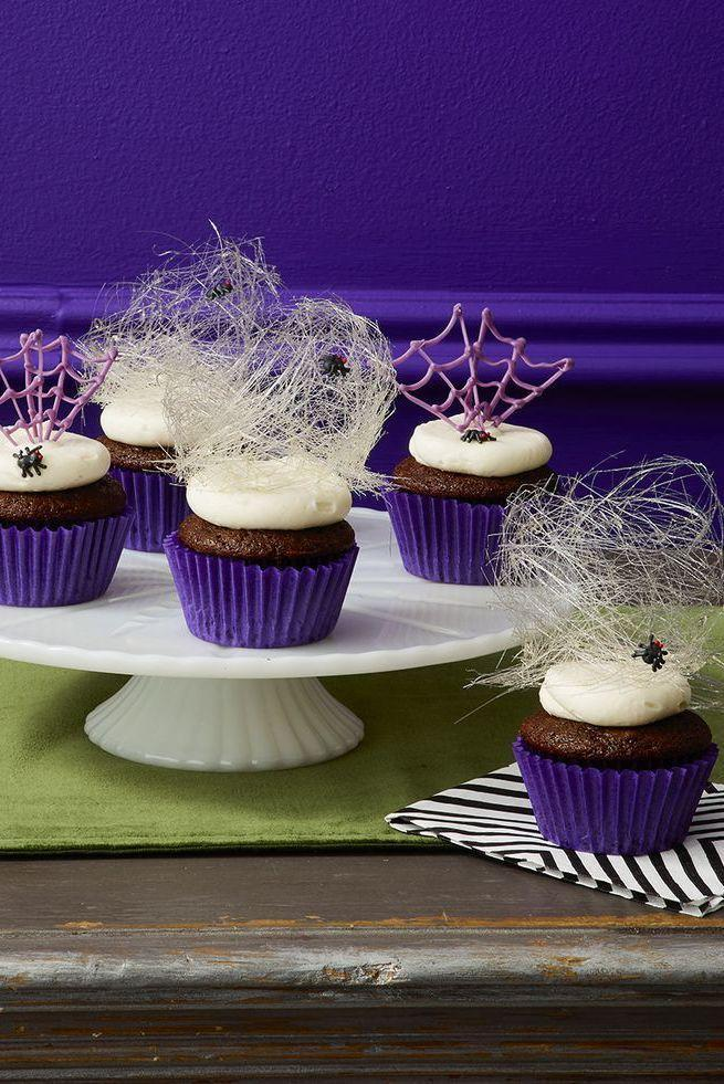 """<p>This eek-worthy dessert is topped with spun-sugar webs.</p><p><em><a href=""""https://www.womansday.com/food-recipes/food-drinks/a29129422/spider-cupcakes-recipe/"""" rel=""""nofollow noopener"""" target=""""_blank"""" data-ylk=""""slk:Get the Spider Cupcakes recipe."""" class=""""link rapid-noclick-resp"""">Get the Spider Cupcakes recipe.</a></em></p>"""