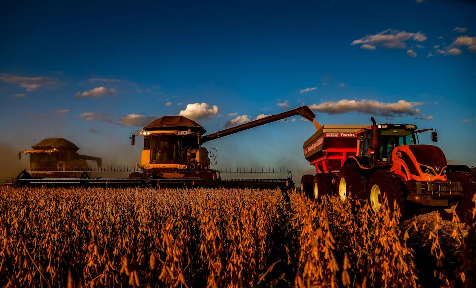 Combine harvesters crop soybeans in a field at Salto do Jacui, in Rio Grande do Sul, Brazil, on April 7, 2021. - Rio Grande do Sul is the third-largest state producer of grain in the country, which is the world's largest producer of soy. According to the Ministry of Agriculture, production should reach a new record, estimated at 135.5 million tons, approximately 8.6% more tons than the 2019/20 harvest. (Photo by SILVIO AVILA / AFP) (Photo by SILVIO AVILA/AFP via Getty Images)