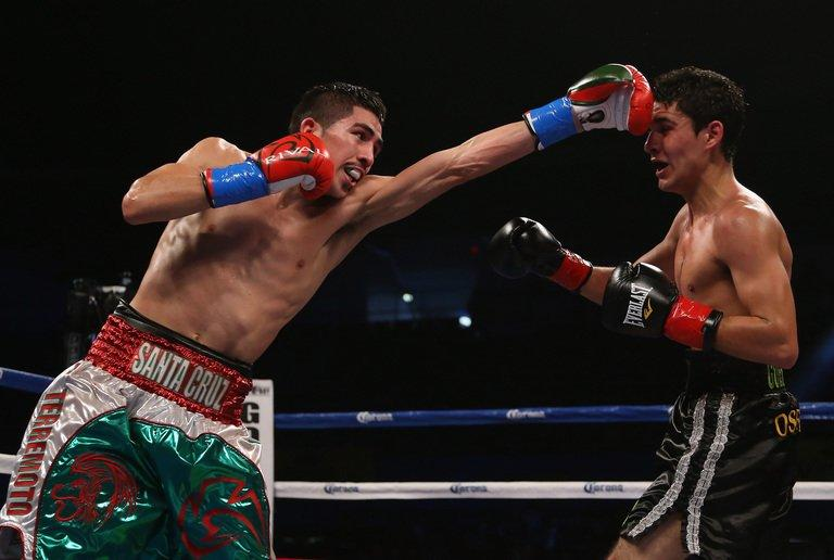 Leo Santa Cruz (L) throws a left hand at Alberto Guevara in Los Angeles on December 15, 2012