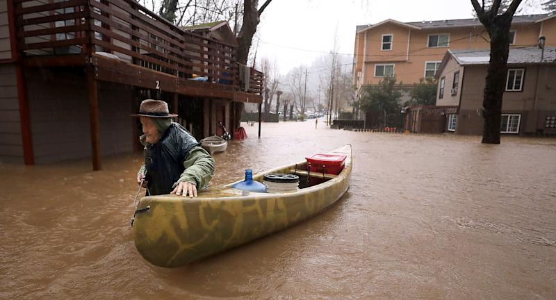 Sycamore Court resident Jesse Hagan evacuates to higher ground in the apartment complex in lower Guerneville, Calif., Tuesday, Feb. 26, 2019. The town of Guerneville and some two dozen other communities are at risk of flooding from the Russian River north of San Francisco.