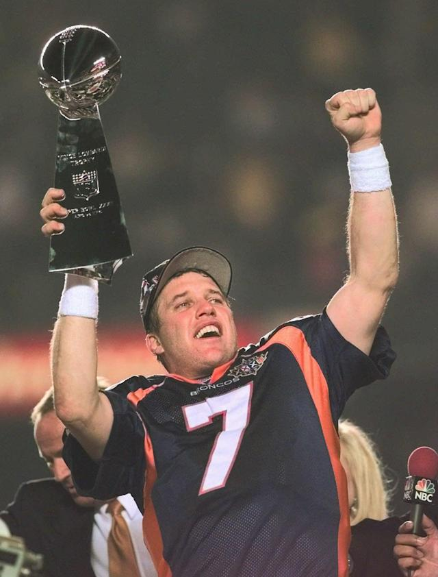 ADVANCE FOR WEEKEND EDITIONS, AUG. 9-10 - FILE - In this Jan. 25, 1997 file photo, Denver Broncos quarterback John Elway holds the Super Bowl trophy as he celebrates the Broncos 34-21 victory over the Green Bay Packers in Super Bowl XXXII in San Diego. The salary cap, extra playoff games and a league bent on parity have made the NFL one of the planet's most competitive leagues, where champions fall quickly and teams regularly make one-season turnarounds. (AP Photo/Dave Martin, File)