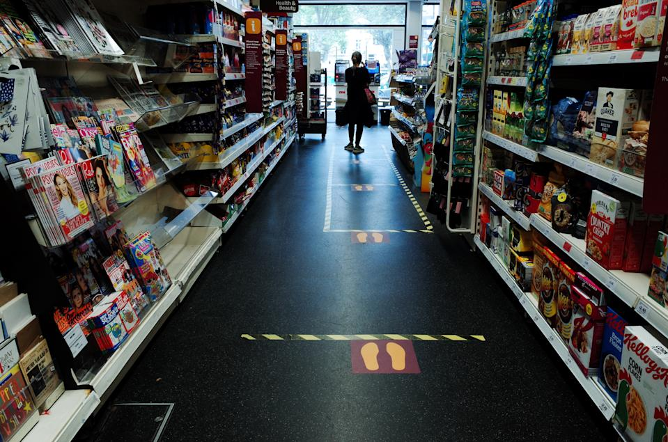 Social distancing markers subdivide the aisle space of a branch of supermarket chain Sainsbury's in the Bayswater district of London, England, on May 13, 2020. Today marked the first day of several eased restrictions across England as a slow loosening of the coronavirus lockdown gets underway, with people now encouraged to return to work if unable to do so from home and unlimited outdoor exercise now allowed. Non-essential shops will not be permitted to reopen before at least June 1, however, and the hospitality sector is to remain closed until at least July 4. With those closure orders still in place, much of central London, which is mostly comprised of retail and hospitality venues, remained largely as deserted today as it has been in recent weeks. (Photo by David Cliff/NurPhoto via Getty Images)
