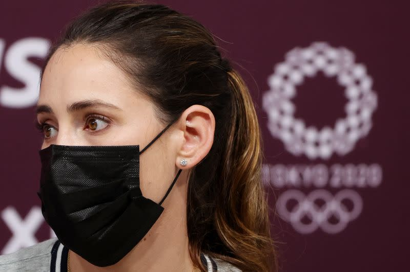 Showjumper Jessica Springsteen of the United States' Olympic equestrian team speaks at a new conference in Tokyo