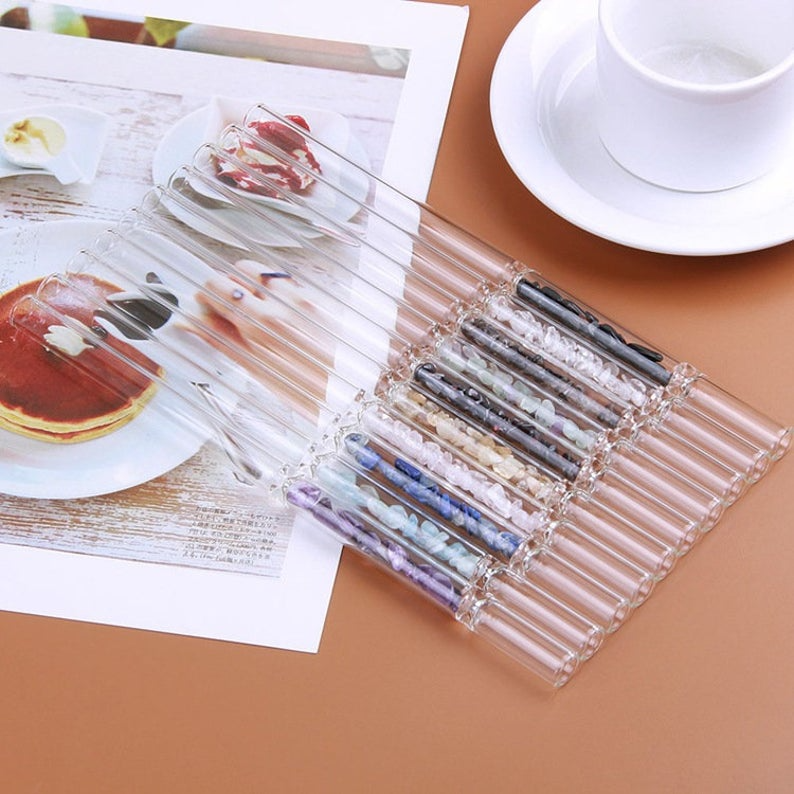 """<h3><strong>Healing Crystal Reusable Straws</strong></h3><br>The trifecta of a sweet, sustainable, and self-care essential — these luminous, reusable straws are adorned with healing crystals that promote positive energy with each sip. <br><br><strong>Druzyworld</strong> Natural Gemstone Glass Drinking Straw, $, available at <a href=""""https://go.skimresources.com/?id=30283X879131&url=https%3A%2F%2Fwww.etsy.com%2Flisting%2F895047304%2Fpretty-natural-gemstone-drinking-straw"""" rel=""""nofollow noopener"""" target=""""_blank"""" data-ylk=""""slk:Etsy"""" class=""""link rapid-noclick-resp"""">Etsy</a>"""