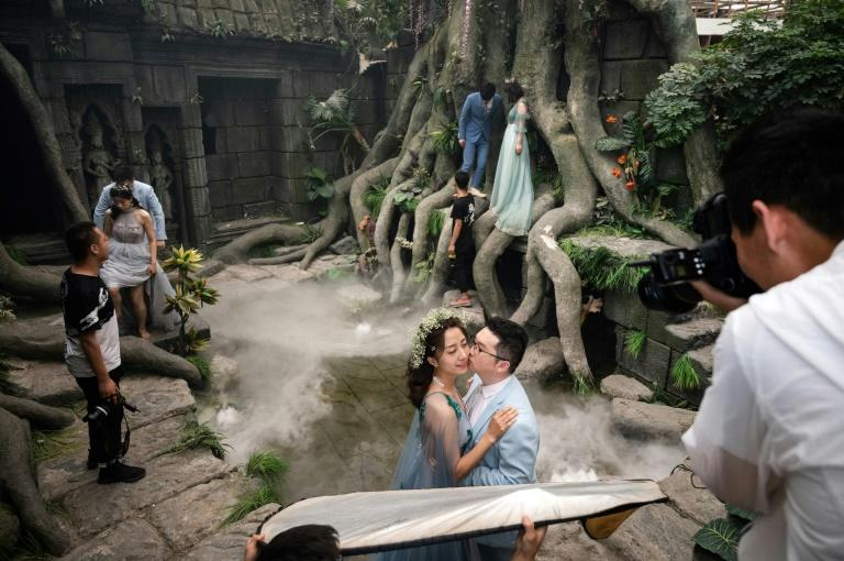 A sprawling complex in Beijing offers wedding photos for couples who can't afford to travel