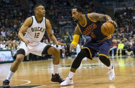 FILE PHOTO: Apr 5, 2016; Milwaukee, WI, USA; Cleveland Cavaliers guard J.R. Smith (5) drives for the basket as Milwaukee Bucks forward Jabari Parker (12) defends during the first quarter at BMO Harris Bradley Center. Mandatory Credit: Jeff Hanisch-USA TODAY Sports / Reuters Picture Supplied by Action Images