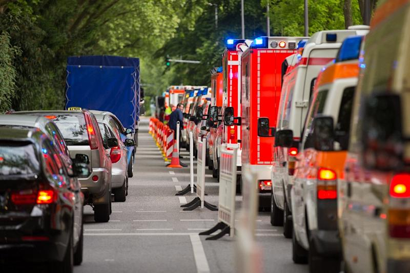 Ambulances line up in front of a building of social services during an evacuation of 20,000 from their homes in Cologne, western Germany, on May 27, 2015 (AFP Photo/Rolf Vennenbernd)