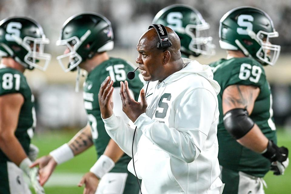 Michigan State's head coach Mel Tucker talks with players during the fourth quarter in the game against Nebraska on Saturday, Sept. 25, 2021, at Spartan Stadium in East Lansing.