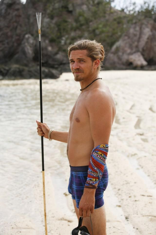 Malcolm Freberg with fishing spear on Survivor: Game Changers