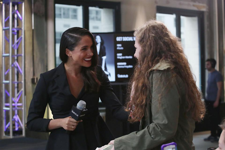 Meghan Markle meets Emily, a fan who she connected with on Twitter, at AOL Build in 2016. (Photo: Mireya Acierto via Getty Images)