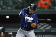 Tampa Bay Rays' Ji-Man Choi swings at a pitch from Baltimore Orioles relief pitcher Travis Lakins Sr. during the sixth inning of a baseball game, Tuesday, May 18, 2021, in Baltimore. (AP Photo/Julio Cortez)