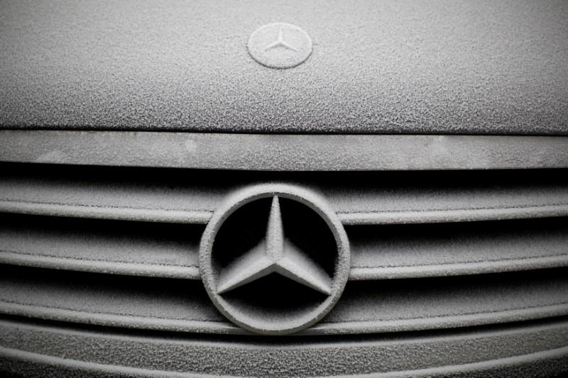 Snowflakes are seen on the grille badge of a Mercedes-Benz car in Warsaw