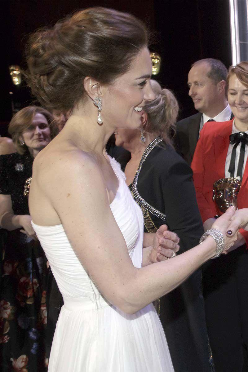 """<p><a href=""""https://www.harpersbazaar.com/celebrity/latest/a26272422/kate-middleton-prince-william-baftas-2019-red-carpet/"""" rel=""""nofollow noopener"""" target=""""_blank"""" data-ylk=""""slk:Attending the BAFTAs"""" class=""""link rapid-noclick-resp"""">Attending the BAFTAs</a> in a one-shoulder Alexander McQueen gown, Kate looked like a true princess with her twisted updo. </p>"""