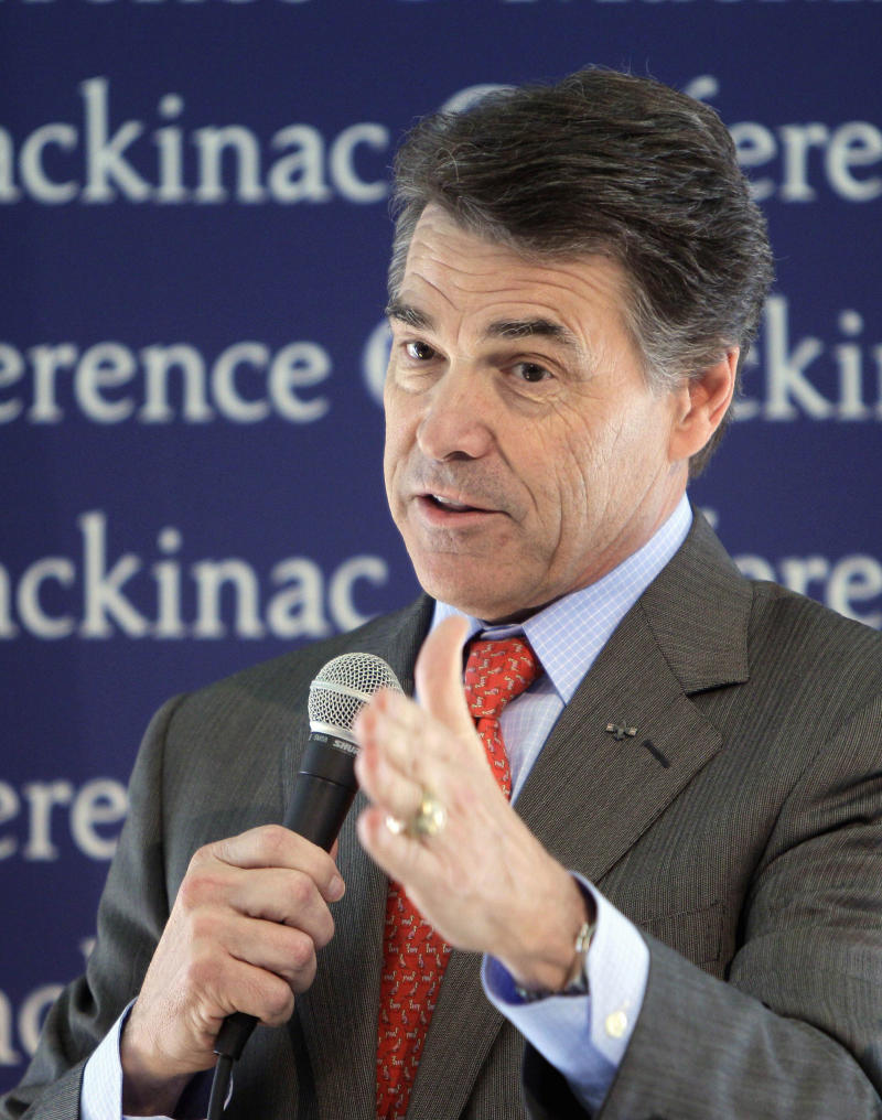 FILE - In this Sept. 24, 2011 file photo, Republican presidential candidate, Texas Gov. Rick Perry addresses the Republican Leadership Conference on Mackinac Island, Mich. Call it a personal class war: Texas Gov. Rick Perry, the son of a cotton farmer, is trying to draw sharp class lines with his chief GOP presidential rival, the very well-heeled former Massachusetts Gov. Mitt Romney.  (AP Photo/Carlos Osorio, File)