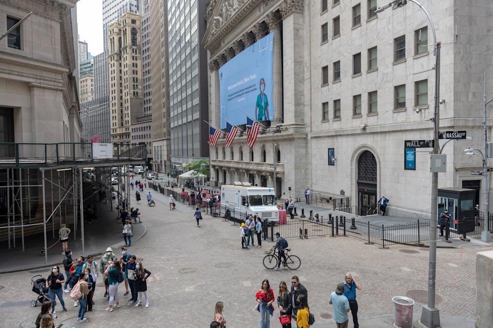 NEW YORK, NEW YORK - MAY 28: A view of the New York Stock Exchange in Lower Manhattan on May 28, 2021 in New York City. On May 19, 2021 all pandemic restrictions, including mask mandates, social distancing guidelines, venue capacities and restaurant curfews were lifted by New York Governor Andrew Cuomo. (Photo by Alexi Rosenfeld/Getty Images)